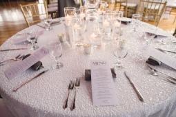 wedding menu printed on woodgrain textured paper