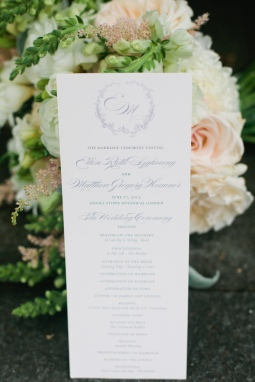 custom wedding program with floral wreath and monogram