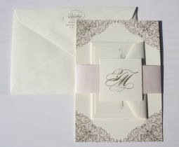 Beautiful gold engraved wedding invitation suite with a soft peach shimmery belly band